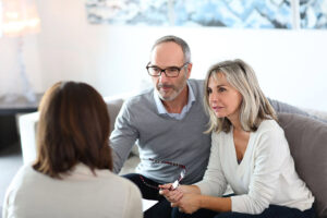 Couple talking with lawyer about Estate Planning