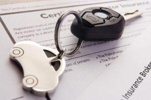 Car Keys on top of Car Insurance Documents